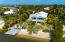 Freshly updated home with sandy beach, dockage, a roof top deck and bay views