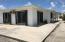 Concrete walkways surround home