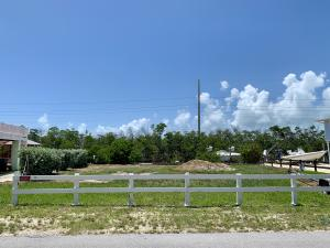 Street view of fenced lot