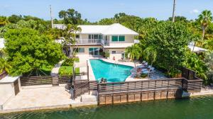 This magnificent turnkey home is one of the few residential waterfront properties located on the island of Key West.