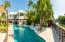 The large pool features a cabana and meticulously maintained landscaping.