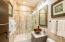 The bathroom for the second and third bedrooms is convenient to both.