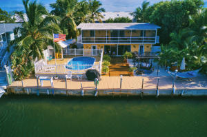 Beautifully Renovated Waterfront 6 Bedrooms 4 Full Baths 2 Kitchens, 3BR/2BA Kitchen Upper Level and 3BR/2BA Kitchen Legal Lower Level. Pool-Tiki Hut and Separate Hot Tub being offered TURNKEY! Park Multiple Boats along the Spacious 75 Ft. Dock with Power/Water, Easy 5 Minute Ocean Access via Tavernier Creek. Excellent Rental Income Property, Generates $7,000 per month for both the Upper and Lower Level. This Home is PRISTINE! NO HOA FEES!