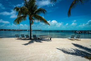 Private Keys style beach maintained daily with beautiful views of the neighboring Marina.
