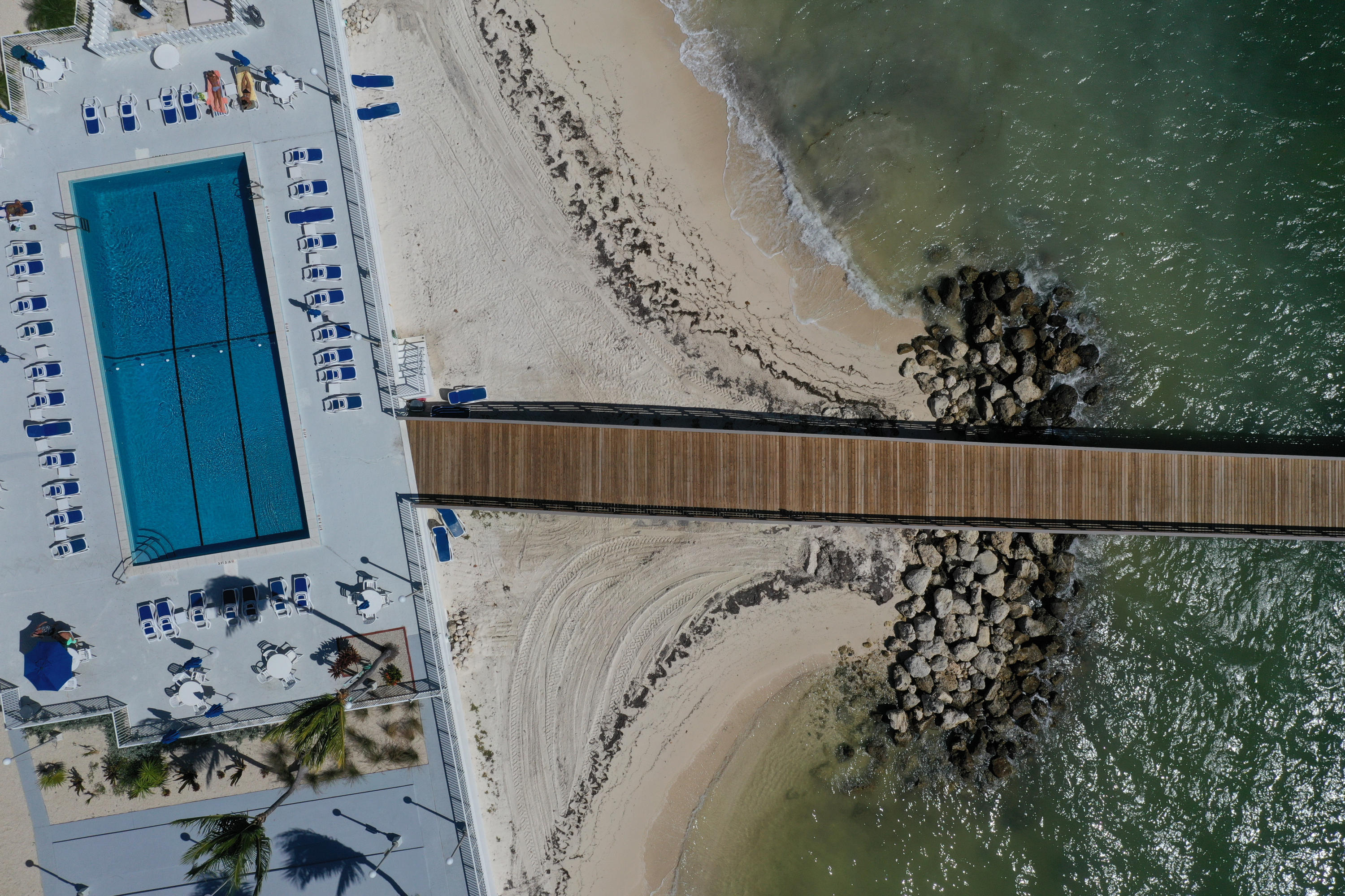 Bird's eye view of pool and pier