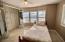 New carpet, mirrored bi-fold closet doors with custom built-in shelving