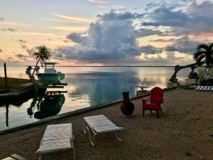 Double lot on exit of canal 120 ft of waterfront 3000+ sq.ft. home