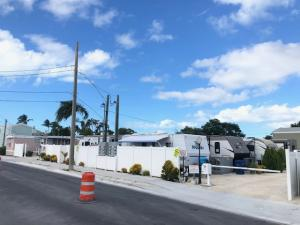 Rarely available Income Producing Waterfront Trailer Park on Stock Island.  Very clean and well maintained.  Most of the trailers are newer and have been replaced over last few years. All tenants long term with one year leases.  Park is gated which may allow for transient use or RV Park.  Total of 14 rental units plus one free mobile home for gatekeeper. Letter of Understanding from County recognizing 12 units.  All units have separate electric meters & connected to central Sewer & Water. Total of 9 trailers, 2 Mobile Homes, Concrete Block house divided up as a duplex and one Nice 2b/2ba modular home on the water.  Property is 1/2 acre or 23,225 sf. with 150' of Waterfront with wooden docks. Owner applied for baybottom lease with State.