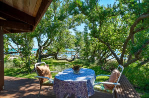 Enjoy peaceful views of the water, and ocean breezes through the mature buttonwoods...