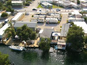 Rarely available Income Producing Waterfront Trailer Park on Stock Island.  Very clean and well maintained.  Most of the trailers are newer and have been replaced over last few years. All tenants long term with one year leases.  Park is gated which may allow for transient use or RV Park.  Total of 14 rental units plus one free mobile home for on site manager. Letter of Understanding from County recognizing 12 units For Redevelopment.  All units have separate electric meters & connected to central Sewer & Water. Total of 9 trailers, 2 Mobile Homes, Concrete Block house divided up as a duplex and one Nice 2b/2ba modular home on the water.  Property is 1/2 acre or 23,225 sf. with 150' of Waterfront with wooden docks. Owner applied for baybottom lease with State.