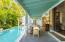 Private veranda overlooking pool and bar area