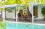 Two French doors opening to poolside.