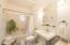 Bathroom (#1) with bathtub, high ceiling with chandelier