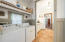 Laundry room conveniently located off the kitchen with washer & dryer