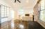 Upstairs bedroom (#4,Hardwood floors. Three windows and one wall of oversized interior windows