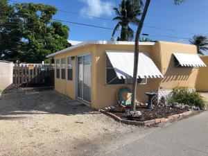 How about this charming tiny, affordable home. New handmade wood shutters, Metal roof & community boat ramp.