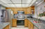 Stainless appliances and blue pearl granite countertops.