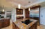 Wolf electric range in the island, Kitchenaid refrigerator and wine cooler