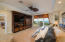 Located on the main living level with his and hers full baths and dressing areas