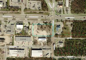 TRAFFIC LIGHT CORNER, located at main intersection in Big Pine Key on the Overseas Hwy. Almost one acre of commercial land with approximately ~271 feet of highway frontage and 573sf structure. Zoned Sub Urban Commercial with proposed redevelopment. SC zoning allows for 18 affordable units per acre, verify with County for specifics.