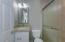 Guest Bathroom with custom tiled walk in shower