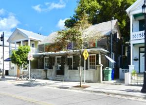 Lease is plus NNN. Ground floor retail space with covered front porch across the street from the Ram's Head. Split into 2 rooms with hardwood floors throughout. There is currently a full kitchen in the space. Pool in back is shared with other commercial tenant, including pool upkeep. Good pedestrian foot traffic from Patronia St. shoppers as well as tourists on the way to Hemingway House on next block. Available August.