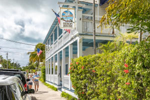 Heron House Court is a well maintained Historic Key West Treasure w/ Central Signature Old Town location, this charming island retreat is a only a short walk to Duval Street's diverse tourist attractions, shops, clubs, restaurants & convenient to the Historic Seaport boardwalk! Stylish Conch setting, originally built 1929 w/ many upgrades throughout the years, 15 deluxe rooms, licensed 14 transient. Relaxed Cozy Atmosphere, expansive covered porches, decking & lush gardens surrounding the outdoor heated pool. Sold fully furnished, includes all equipment, software with business. Excellent investment opportunity to own a very well established Guest House with proven rental history.