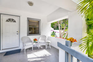 Watch the world go by from this cute front porch