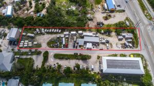 Eight lots totaling close to an acre of land with highway frontage zoned Suburban Commercial. Liberal zoning allows for multiple uses. Currently being used as an Automotive repair shop and U-Haul storage/rental facility.