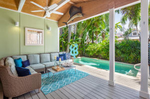 This successful Old Town Key West transient licensed vacation rental is located just steps off Duval Street! It's in the Gallery District of South Duval. Close to Key West shopping, restaurants and nightlife! This 4 bedroom property has 2 bedrooms and 2 baths in the main house. The great room, kitchen, bathrooms. large covered lanai and private salt water, heated pool are newly constructed. There are 2 guest suites, one poolside and one upstairs with private balcony, each with their own bathroom. This arrangement is perfect for traveling with friends or family., There is room for 8 people to comfortably dine outside. A covered outdoor living space with large sofa, chairs & lounges are perfect for entertaining. Off street parking completes this highly desirable investment property.