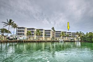 Penthouse Corner unit! Pristine condition. Privacy, No rentals, enclosed Garage with Boat lift on 200 ft wide canal on Deep water dockage and Cocoplum Beach is just down the street. Tennis courts, pool, the entire building including elevator, fencing, grounds, building exterior everything has been upgraded in last 3 years. Impact windows and sliders, wine cooler, Granite Kitchen, screened in porch, corner unit has larger views, and so much Natural light.