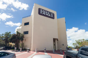 The BB & T building is a centrally located landmark in one of the best areas in Key West.  A prestigious location for this expansive second floor condominium executive office suite. Ideally suited for any professional office; medical, attorney, accountant, investment, real estate and or continued insurance enterprise.   This tastefully decorated and expansive office suite offers many desirable features:  More than 1900 sq. ft., 2-private balconies facing east and west, kitchen, reception, multiple private offices, bull-pen, conference and ample storage.  Common area baths located immediately adjacent  to the suite.  The CAM monthly fee includes the utilities; insurance, building maintenance and 24 hour security.  Seller financing available.  Office furnishings negotiable.