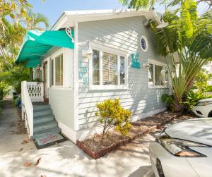 Just Listed!  Seller Finance Possible! Spacious commercial condominium is centrally located in Mid Town Key West. Just off Flagler Avenue it is an ideal location for professional offices & more. This property has a large open main area, private office, kitchenette, storage, and 1.5BA. Low condominium fee. This is the only commercial unit in the triplex, other two units are residential. The condominium has central AC, bambooflooring, 3 off street parking spaces, & deck.  The zoning is CL (Limited Commercial District). Do not disturb business.