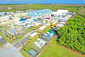AMAZING OPPORTUNITY - Large property with US1 frontage in the heart of the Florida Keys. Currently used as self storage and RV storage with propane filling and Penske truck rentals. There is plenty of room for improvement with the existing business (add air conditioned storage - records storage - add elevators - automate access). OR use the 2 warehouses and extra large lot for YOUR business.