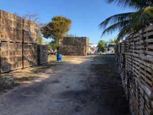 Canal front vacant lot zoned as Commercial Fishing Special District.  One of the last working trap yards in the keys, 11388 square foot lot.