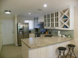 Completely remodeled and like brand new unit in this bay front community. Resort amenities with gated entrance Modern and bright.  View of pool from the balcony and bedroom.  A kitchen you'll love cooking in. Large walk-in showers.  Roomy master suite.  The unit's open floor plan  is great for  at home dining and entertaining. Beautiful new marina for all your boating needs. Boat ramp and Dry storage for boats.  Storage for kayaks.   Other amenities include 2 pools, 2 tennis courts, a bocce ball court and a great clubhouse.  Beautiful sunsets from the pier.  Easy commute from and to Miami. You will walk in and say WOW!!  Your Keys Paradise awaits.