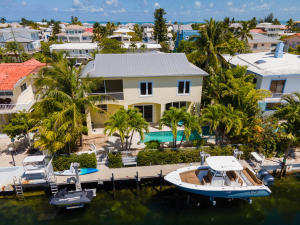Pool with spa, 2 boat lifts, garage, 4 bedrooms and 3 1/2 baths