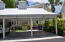 2 Carports in front of home