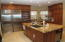 Island Kitchen with Wolf, Miele and Thermador top of the line professional appliances in two kitchens.