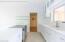 Kitchen leading to bonus storage room/workshop