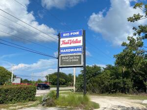 US Hwy 1 Commercial Property with over 320' of US 1 frontage.  Approx. 31,388 SqFt of existing floor area, 5500 Sq Ft warehouse (with additional 2000 SqFt available on original permit). Two additional warehouses with approx. 2730 SqFt, storage, hardware store, 2 apartments (2500SqFt), equipment and totally fenced. This is one of the largest Commercial Properties in the Lower Florida Keys with over 2.3 acres of land. Property income is derived from the hardware store, warehouse rentals, apartments, storage, raw material storage & delivery! Please do not disturb the businesses, potential Buyers must sign an NDA for additional materials & financials
