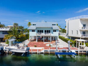 65 ft. of dockage with 2 boat lifts and peek-a-boo bay views!