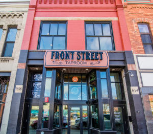 2016 new storefront. Sandstone address and year markers. New windows. Exterior lighting and security.