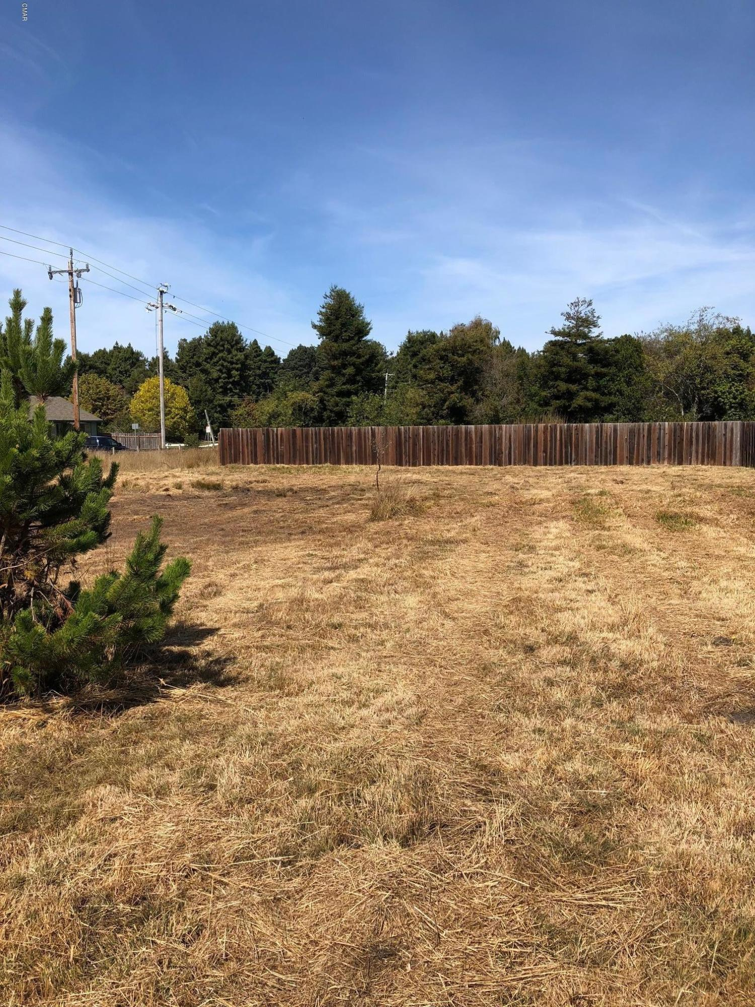 This double lot is located on a street with no through traffic and bordered on two sides by a wetland preserve. No one can build behind or to the north of parcel. This parcel is a sunny location with southern and western exposure. Sewer main and lateral are stubbed in on the north end of the property and waiting for your house plans. Close to town, schools and shopping. Sellers are willing to contribute $6,500 credit for completion of sidewalk requirement by City of Fort Bragg.