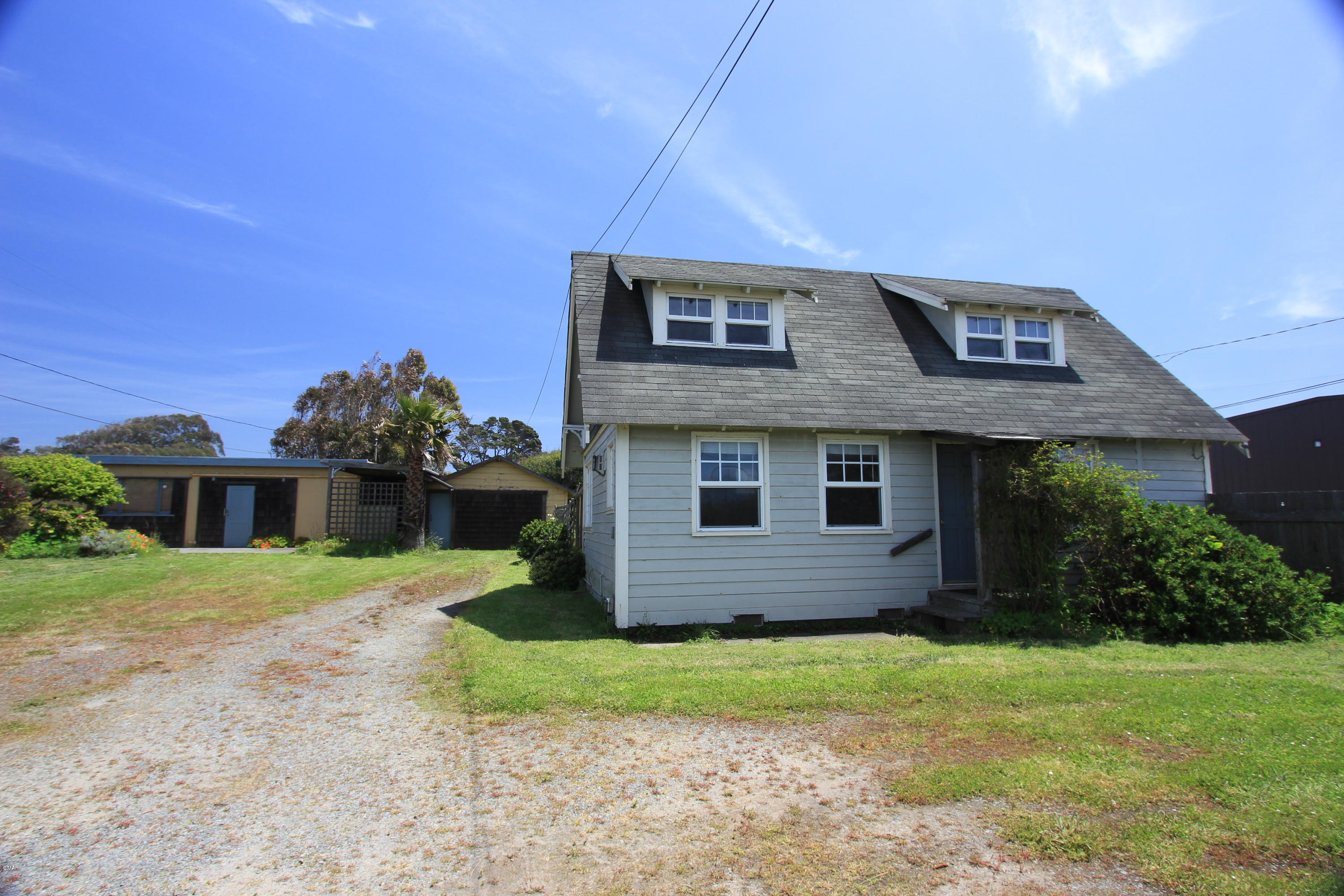 This is the ideal property for the sole proprietor wanting to live close to the shop. Cozy one bedroom home with detached, one car garage and 1,000+ s.f shop with propane heat and 1/2 bathroom. The bungalow has a sunny loft with sweet ocean views. Propane Jotul stove in the living room is an economic and convenient heat source. Zoning of this property is ideal for living and having a light industrial business with Fort Bragg North Main Street Frontage. Check with City Planning for your specific purposes.