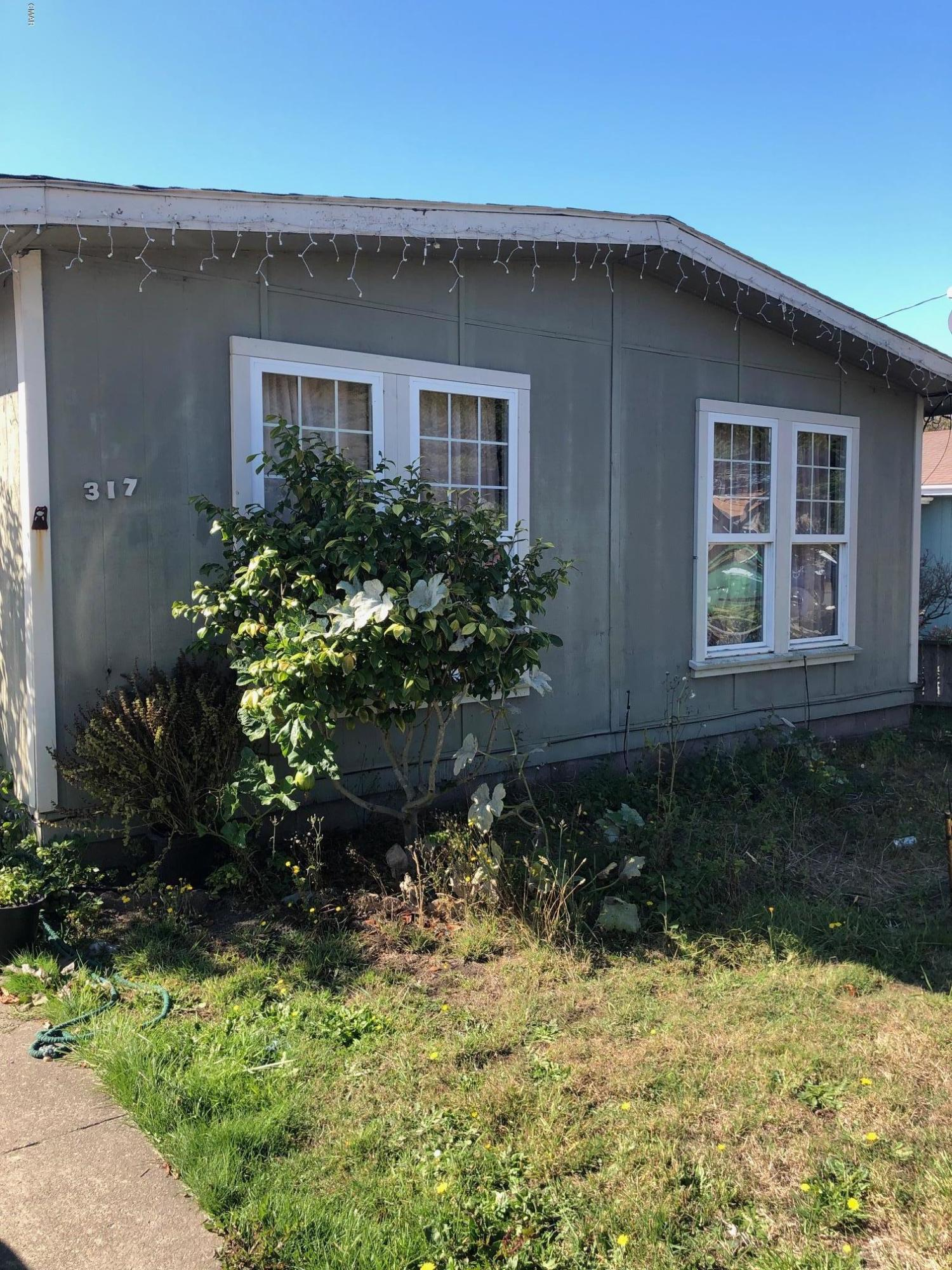 Manufactured home and detached two car garage with studio apartment above has alley access.  Two bedroom, two bath main home with off street parking. Back yard with large deck off the kitchen. Live in one and rent out the other. Just a couple blocks from CVS Community Center and Dog Park. Close to schools.