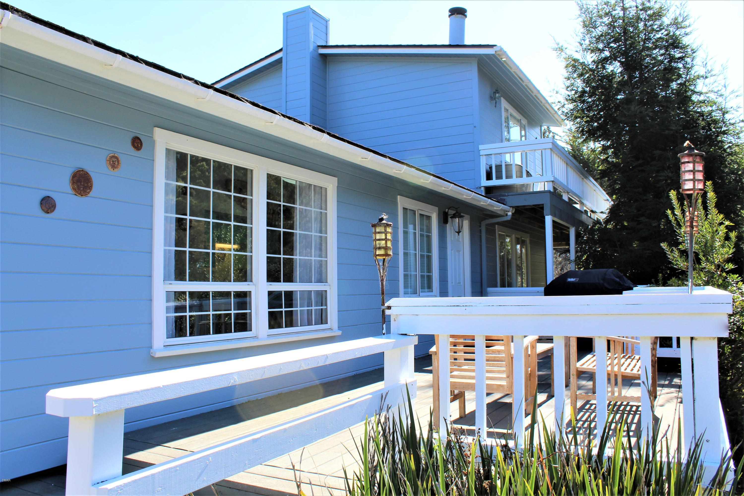 Home with guest unit is perfect for Mendocino get away or full time living.  Just half a mile north of the village on over an acre of park like land with pond. The house has three bedrooms and 1 1/2 baths, furnace, wood burning fireplace and lots of deck space for entertaining.  Upstairs with a separate entrance is a guest studio with bathroom, kitchenette, fireplace and large deck with south west exposure and a peak of the ocean. One or both areas can be vacation rented. Could also be an ideal home office situation.  Lots of possibilities!