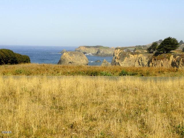 Sited in Ocean Meadows Circle,  a subdivision that boasts quality homes and deeded access to Seaside Beach, this 1.01 acre corner lot offers remarkable views of the Pacific Ocean and it's rugged coastline that span from the north to the south sides of the property.  Gentle, rolling hills provide the backdrop and add to the serene setting.  Few vacant lots are left here. Don't miss this opportunity!