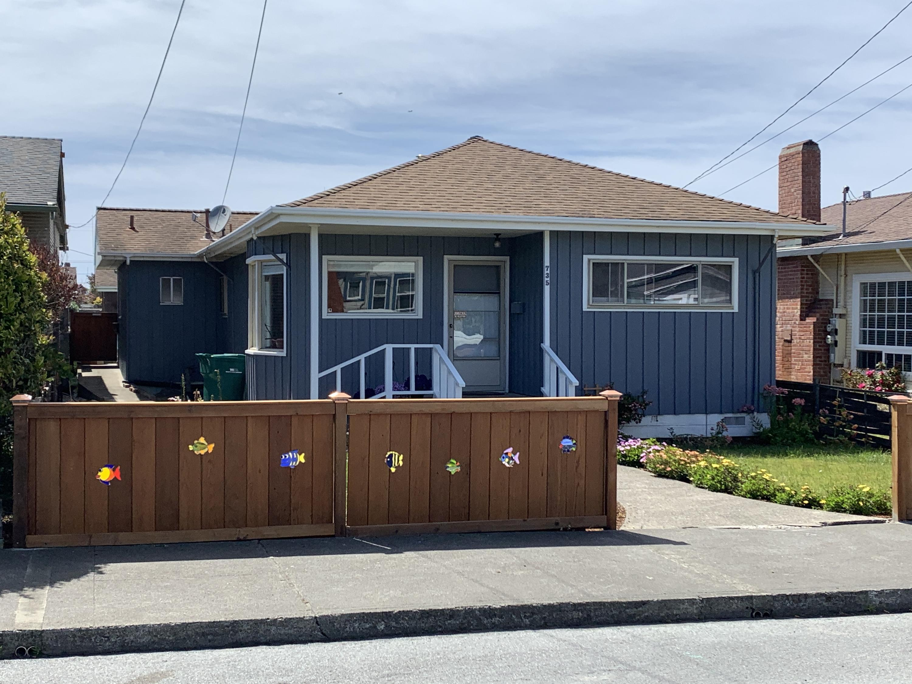 Charming Coastal Cottage, walk to beach or downtown. 3 Bedrooms with good separation, skylights, recent updates throughout. Separate laundry room, rare and HUGE 3 car garage with alley access. Shop has room for cars and your art studio or woodwork, etc. Unique front fence embedded with stained glass fish. Seller is a licensed real estate broker.