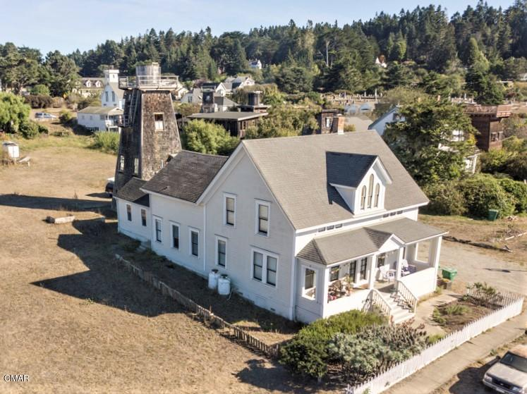 In 1855 Capt. David Lansing built the first Victorian home in Mendocino Village using redwood milled in San Francisco.  Converted to a duplex in 1938 and remodeled in 2012 it is now offered for sale along with a completely rebuilt water tower residence.  Plenty of opportunity here.  1.465 Acres zoned MMU 12k for potential minor subdivision, or a very large yard.  Central heat, perimeter foundation, wood floors, dual pane windows and updated kitchens.  Easy walk to Big River Beach and Village center.  May be the last best investment in the Village.  Captain Lansing took advantage of getting in on the ground floor of the timber rush.  This may be your opportunity to get in front of a new rush to the Mendocino Coast.
